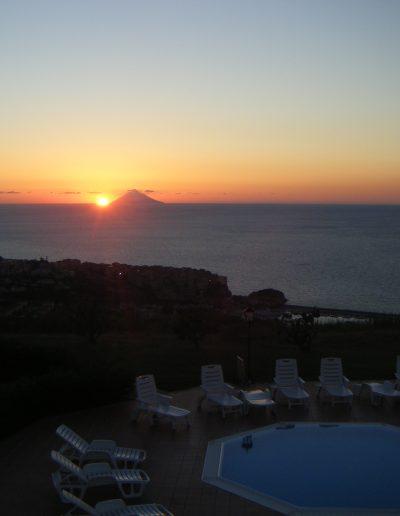 Watch the sun set behind Stromboli