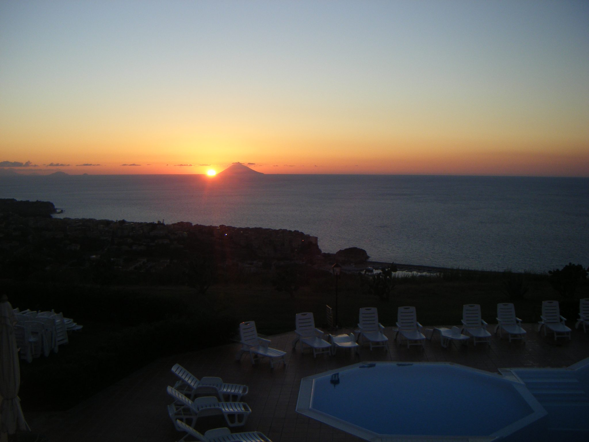 Watch the sun set behind Stromboli