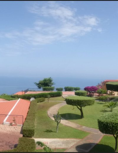 Panoramic view of the gardens and pool that lie in front of our apartments