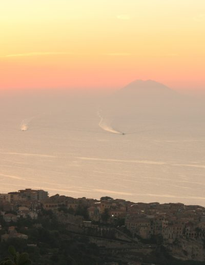 From the balcony watch the sun set & boats return & Stromboli in the distance